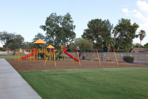 Playground at charter school with swings and slides