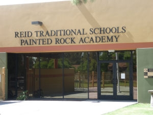 Close view of Painted Rock Academy Charter Schools' Front doors with name above