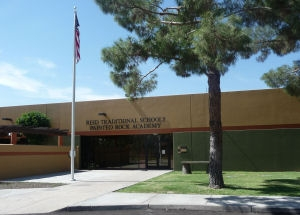 Front Entry of Painted Rock Academy Charter School with Flagpole and large tree