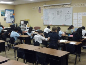 students work at classroom desks in traditional charter school