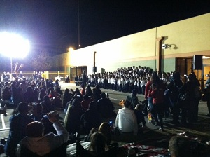 traditional charter school concert outside at night with students and audience spotlighted