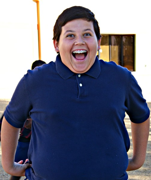 smiling boy in blue polo shirt