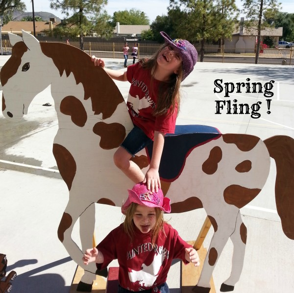 two girls on wooden painted pony