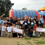 Elementary school charter school classes pose before fundraising race