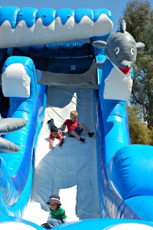 boys on inflatable large inflatable slide