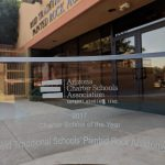 clear glass trophy for Arizona Charter school of the year in front of School, Reid Traditional Schools' Painted Rock Academy