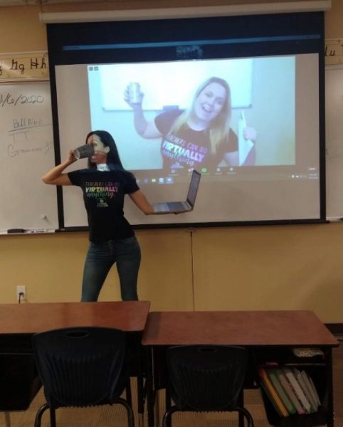 """Two young, fun teachers, one in person, one on-screen, wear t-shirts stating """"teachers can do virtually anything"""""""
