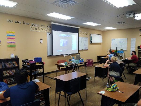 middle school class views guest speaker on screen